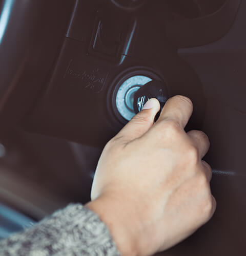 turning car keys to start a car